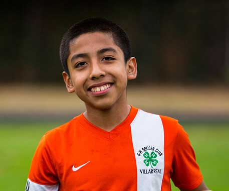 4-H boy in soccer uniform