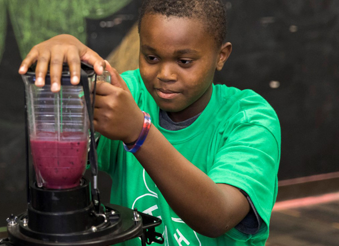 4-H boy creating a healthy snack at home