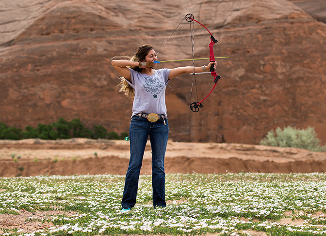 4-H youth learning bow and arrow skills