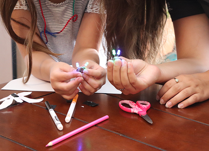 4-H youth building an LED light at home