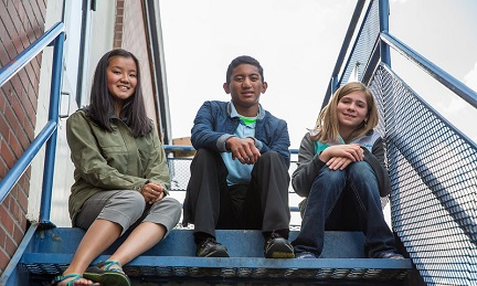 4-H youth sitting on steps
