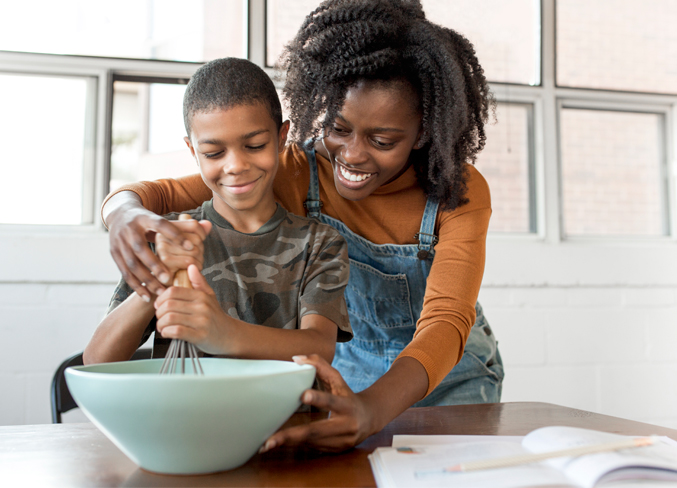 mother and son cooking together at home