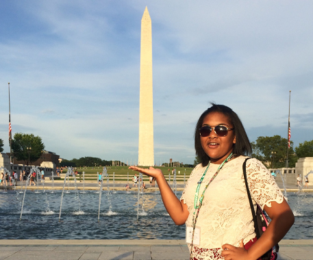 4-H Citizenship Washington Focus participant poses with the Washington monument in her hand